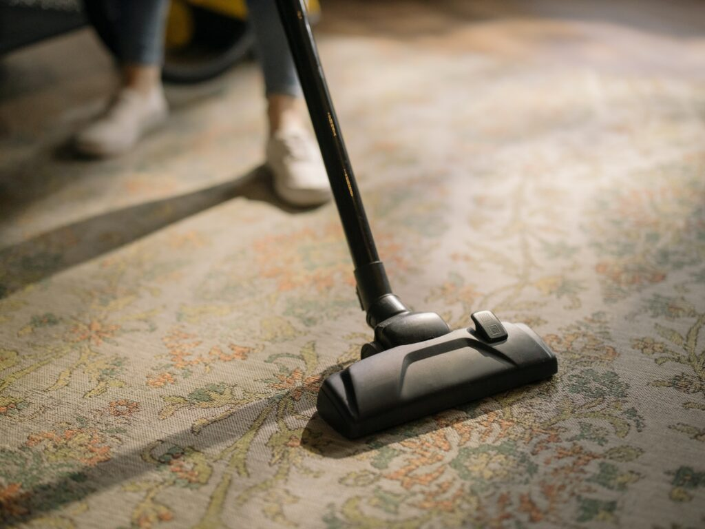 Vacuuming the carpet.