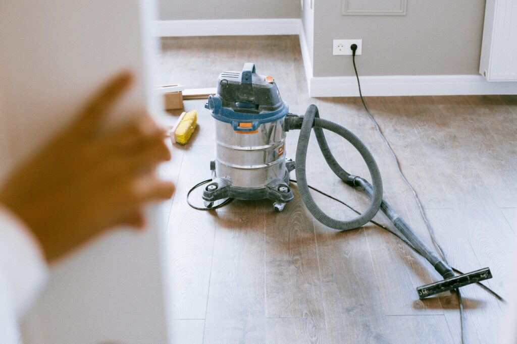 A shop vac in the newly renovated room, necessary for post-construction cleaning
