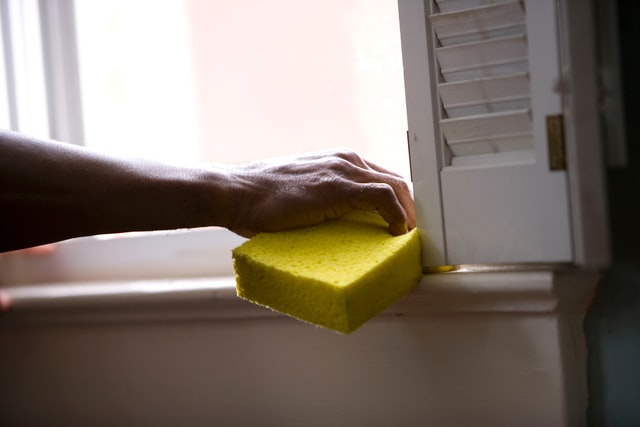a person providing house cleaning service
