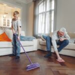Boy and man cleaning floor