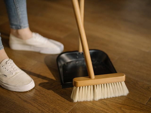 Sweeping with broom and dustpan