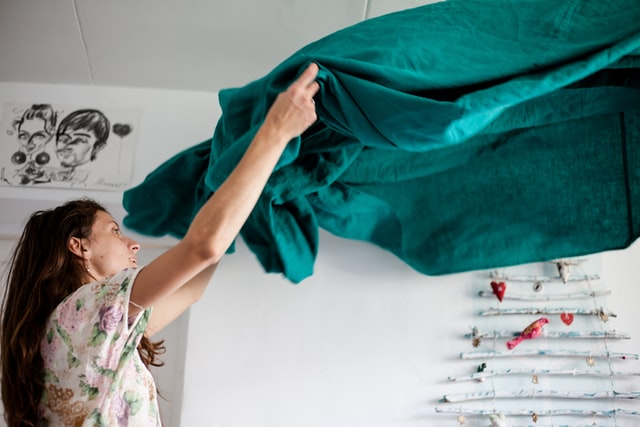 A woman making her bed