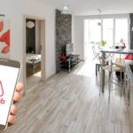 Hand with Airbnb app in home