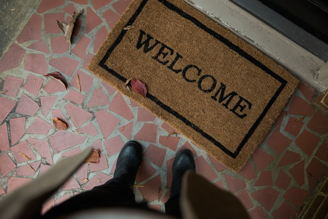 A welcome home mat where you should clean your pet according to pet owner cleaning tips.