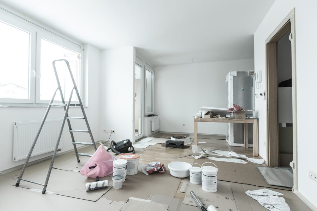 living room filled with construction tools and ladder after a home renovation project