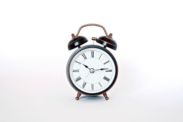 a rustic clock with an alarm